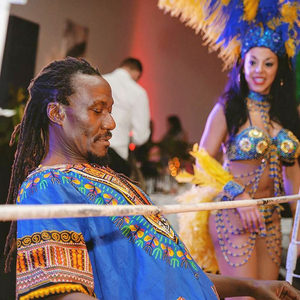 Caribbean Limbo Dancer for hire with Carnival Dancer looking on